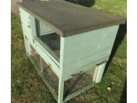 guinea pig hutch - 3 stories with access to grass and large indoor area.