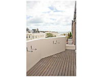 Spacious 3 bedroom holiday penthouse with roof terrace and private parking close to beach and town