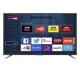 Sharp 32 inch HD TV with Apple TV and Roku streaming stick