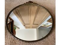 Antique brass framed convex mirror