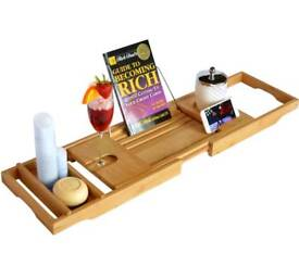 Luxury bamboo bath caddy with slide in glass holder and tablet/book holder.