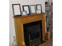 Fireplace with tile inserts and electric fire