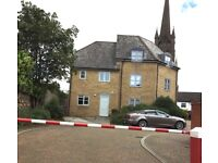Lovely modern home in central Bury St Edmunds with garden and parking within secure development.