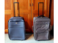 2 excellent condition medium size suitcases with wheels