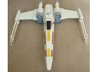 Star Wars collectable X-Wing model with R2D2 pilot.