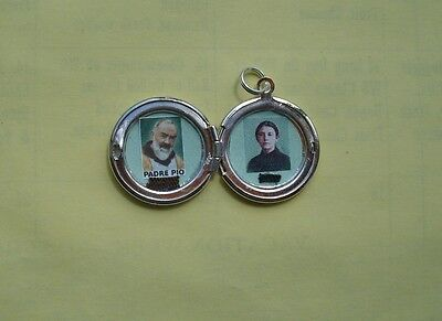 St Padre Pio/St Gemma Galgani combination relic locket in excellent condition