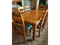 large pine table and 6 chairs