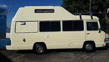 Toyota Coaster pop up hi roof motorhome AUTO turbo diesel $29,999 South Brisbane Brisbane South West Preview