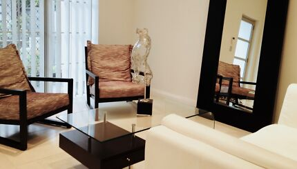 Contemporary upholstered armchair with exposed timber frame