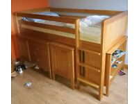 Bed, bookcase and storage unit, chest of drawers, table and bookcase neatly store away under the bed