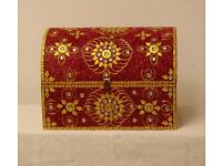 Beautiful hand decorated red and gold encrusted storage chest