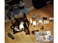 Nintendo Wii with games, microphone, drums and guitars + Wii sports resort