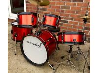 RocketMusic 5 Piece Junior Red Drum Kit as new condition hardly used at all. Suitable for ages 5-10