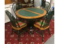 Green tile top extendable dining table and chairs