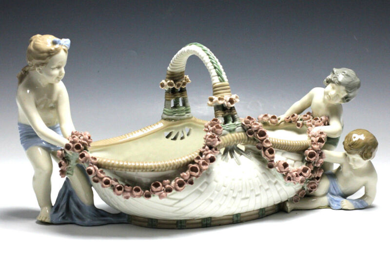 Amphora Porcelain Basket with Cherub figures and floral garland encrusted handle