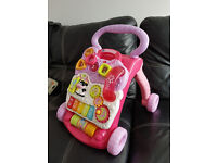 V TECH PINK BABY WALKER , EXCELLENT CONDITION, PLAYED INSIDE ONLY WITH BATTERIES