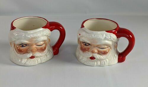 """Set of 2 Vintage Winking Santa Claus Ceramic Mugs Blue Eye 3.5"""" H x 5"""" W Japan"""