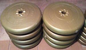 Weightlifting plates (8x25lbs, 12x10lbs, 8x5lbs)