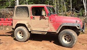 Looking for tires and wheels for 2002 Jeep TJ with lift kit