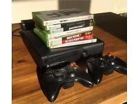 XBox 360 S with 2 wireless controllers and 7 games