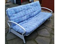 sofa bed / futon, double bed size. In good condition.