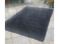 Black deep pile shaggy rug