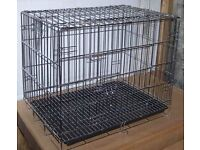 Various sized dog cages for sale