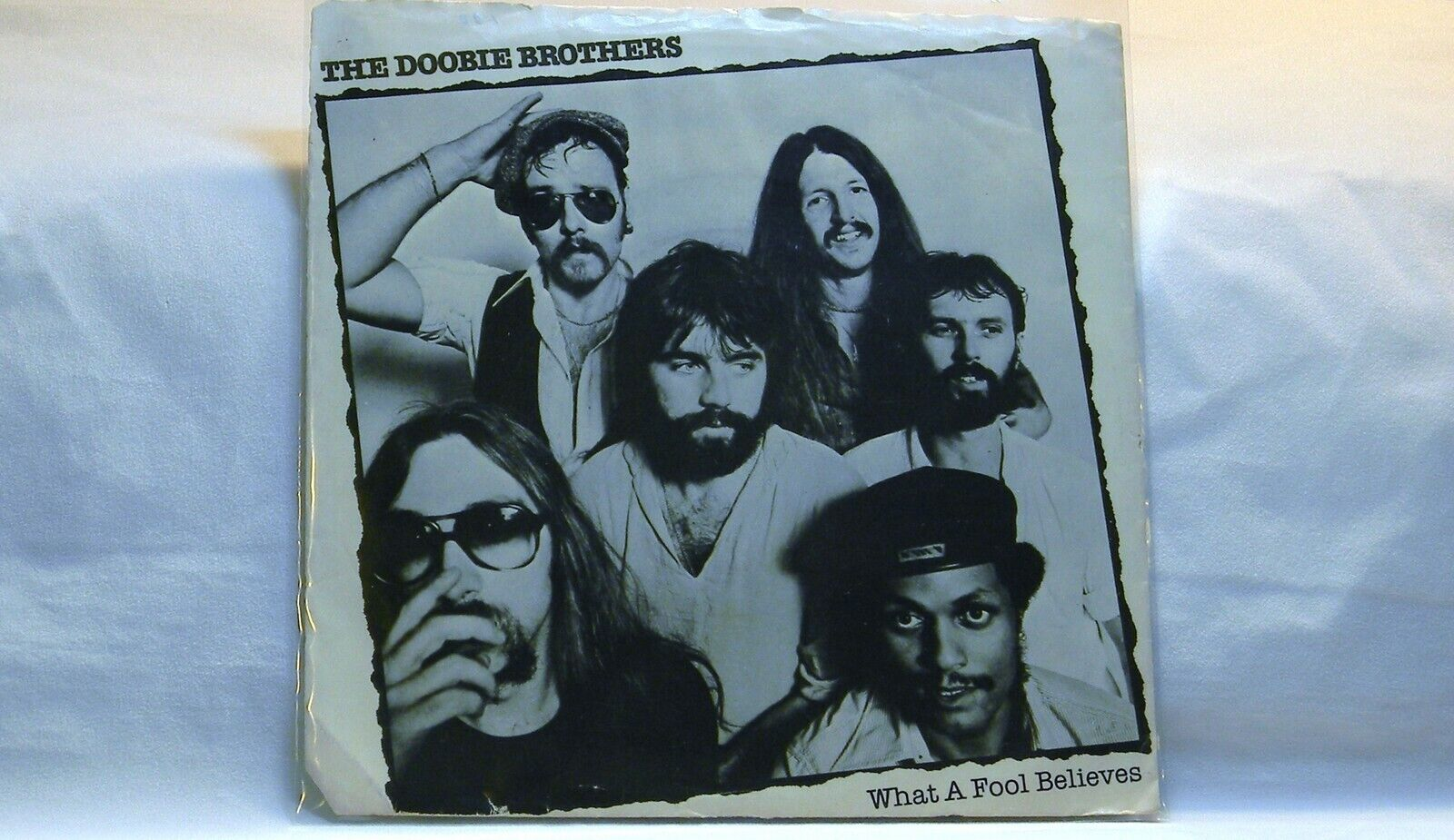 THE DOBBIE BROTHERS WHAT A FOOL BELIEVES 45 RPM RECORD PICTURE SLEEVE ONLY
