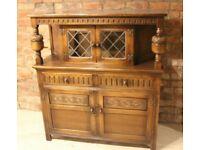 Carved Oak Court Cabinet