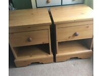 2 Bedside tables on castors with drawer and shelf space - pine colour