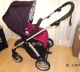mamas and papas SOLA PRAM ,in purple and pink ,with footmuff + raincover and carseat and adaptors