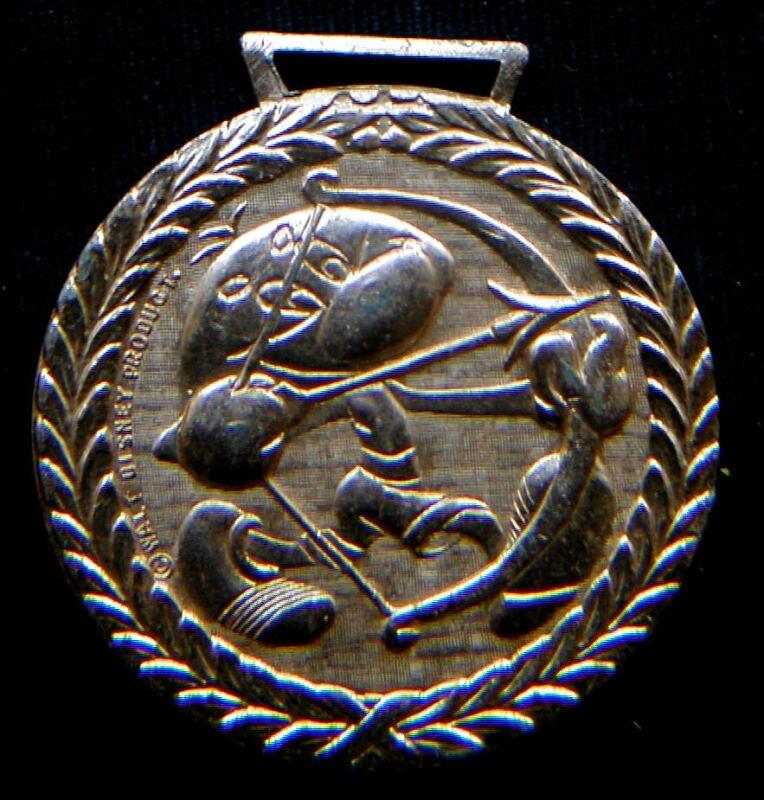 1972 Italy DISNEY rare golden Olympics medal EEGA BEEVA archery