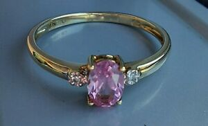 9ct yellow gold diamond and created pink sapphire ring.