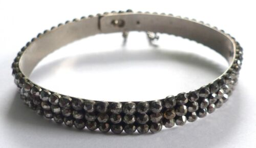 A GEORGIAN CUT STEEL OPENING BANGLE WITH FITTED SAFETY CHAIN