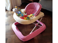 Seated baby walker pink car design with toys on front tray