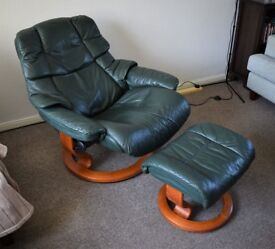 Ekornes Stressless Vegas leather recliner in dark green with matching footstool.