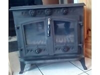 A fantastic looking 2 Door multi fuel stove in great working order first to see will buy.