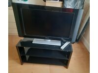 32 inch Philips Tv and Solid black glass Tv Stand
