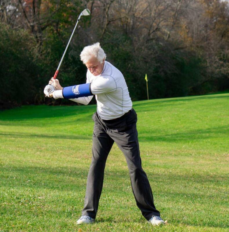 The Straight Arm Golf Training Aid