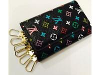 Brand New Louis Vuitton small purse and 6 key holder