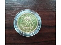 Solid gold coin from Tonga.