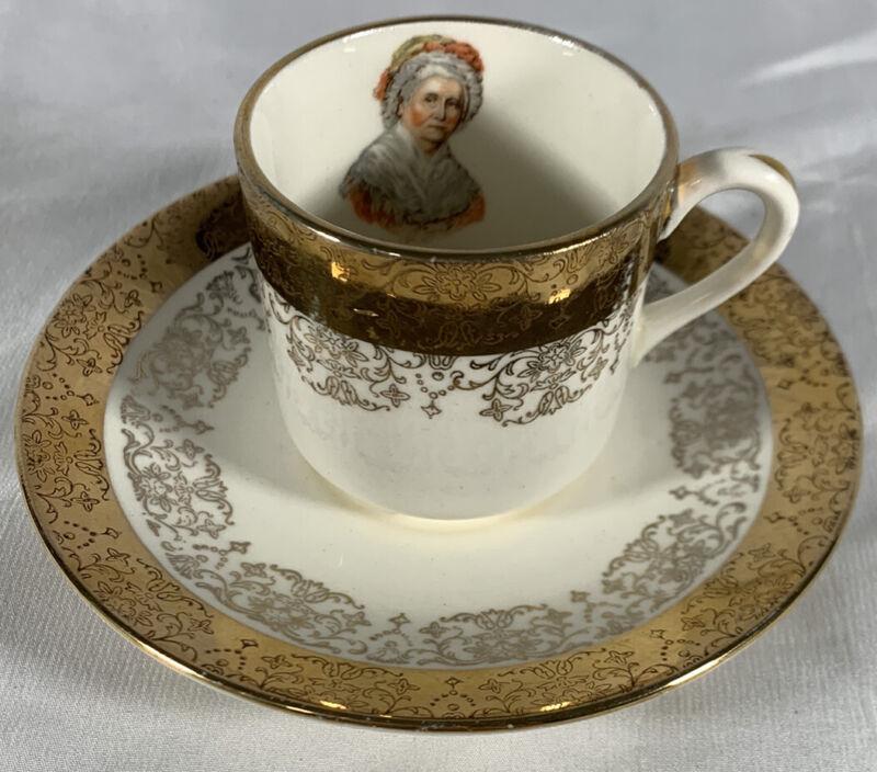 A Capsco Product George & Martha Washington Cup and Saucer Set