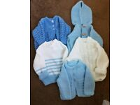 Hand knitted cardigans, baby hats and scratch mitts