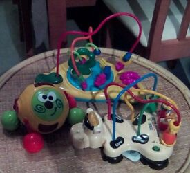 Three different activity toys. One has movable beads, train. One is a a vetch farm, one is a ball.