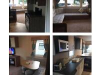 HAGGERSTON CASTLE DELUXE 8 BERTH CARAVAN 3 BEDROOMS ONLY 1 MIN WALK TO COMPLEX
