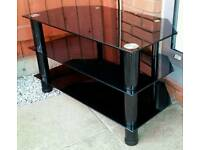 black glass TV table stand. 80cm x 45cm. in very good condition