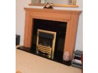 Electric fireplace with marble/wooden surround