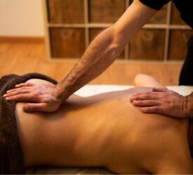 Male masseur full body massage