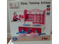 Tabletop toddler toy kitchen for girls and boys.
