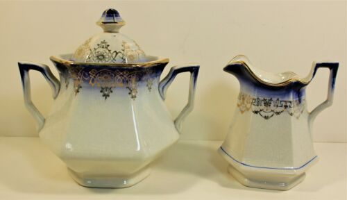 Flow Blue creamer and sugar bowl w/ guilded accent Sterling China